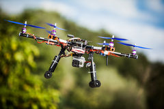 Drone. Professional carbon drone with GPS making a ride stock photo