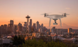 Drone quad copter with camera flying towards the city center Royalty Free Stock Images