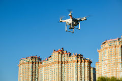 Drone quad copter with digital camera flying over the city Stock Image