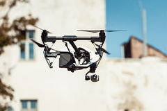 Drone quad copter flying at the building background Stock Image