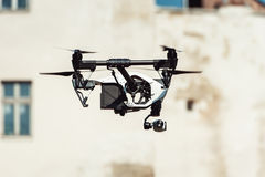 Drone quad copter flying at the building background Stock Photo