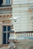 Drone quad copter flying at the building background Royalty Free Stock Photography