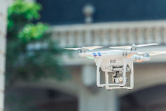 Drone quad copter flying at the building background Stock Photos