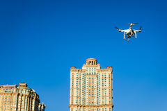 Drone quad copter flying on the city background Stock Image
