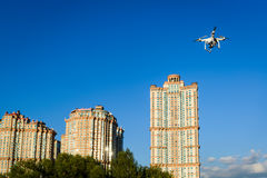 Drone quad copter flying on the city background Stock Images