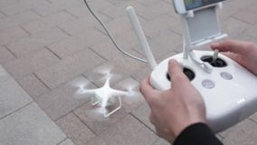 Drone quadcopter aircraft start flying in sky via remote control. Drone quadcopter aircraft flying in sky via remote control stock footage