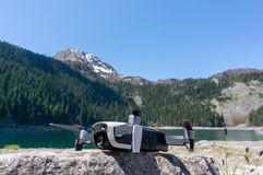 Drone quadcopter on the background natural landscape. Mountain lake. View on Black lake in National park Durmitor. Montenegro royalty free stock photo