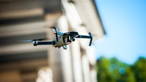 Drone quadcopter with digital camera. Against the sky stock image