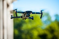 Drone quadcopter with digital camera. Against the sky royalty free stock photography