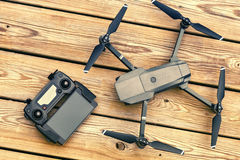 Drone quadcopter with a flight controller over wooden background Royalty Free Stock Images