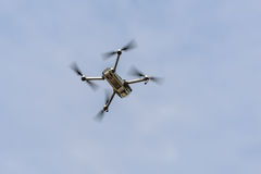 Drone quadcopter in flight Stock Photography