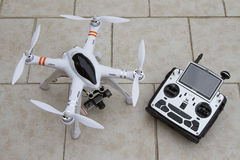 Drone quadcopter with transmitter stock photography