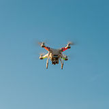 Drone quadricopter with high-resolution digital camera. In flight royalty free stock photography