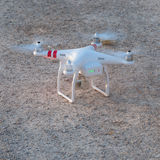 Drone quadricopter with high-resolution digital camera. Resting on the ground royalty free stock photos