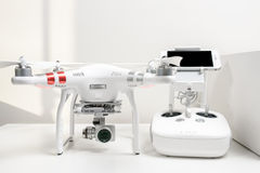 Drone quadrocopter Dji Phantom 3 Advanced. With high resolution digital camera. New tool for aerial photo and video. Isolated on white background stock images