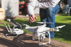 Drone quadrocopter Phantom 3 and pilot. St. Petersburg, Russia - May 4, 2016: Drone quadrocopter Phantom 3 Professional with high resolution camera designed by Royalty Free Stock Photos