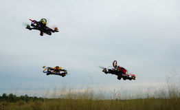 Drone racing over the green field stock image
