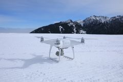 Drone ready for flying. On  winter mountain top Royalty Free Stock Photo