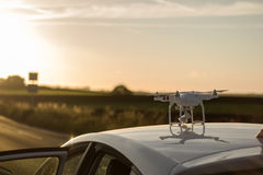 Drone ready for takeover. A drone on top of a car ready for takeoff Stock Photos
