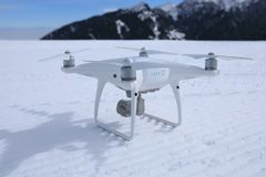 Drone ready to take off at ski piste. On winter mountain top Stock Image