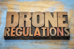 Drone regulations word abstract in wood type Royalty Free Stock Image