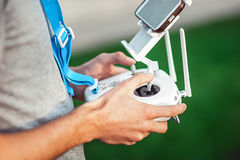 Drone remote control in hand of a man. Man operating of flying drone royalty free stock photography