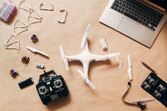 Drone with remote control and laptop, flat lay Stock Photography