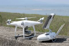 Drone and remote controller. Tool for aerial photo and video stock image