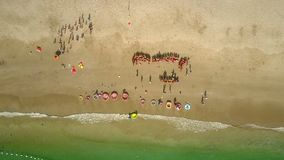 Drone removes up from beach with preschool chidren stock video footage