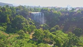 Drone Removes from Waterfall among Tropical Landscape. Drone removes high from gorgeous beautiful waterfall Elephant among tropical landscape against blue sky stock video footage