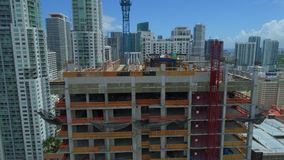 Drone rising over a building under construction. Aerial tower under construction downtown miami stock footage