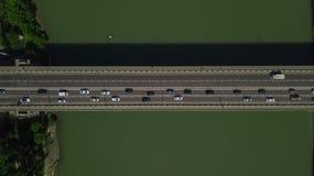 Drone\'s Eye View - Aerial top down view of urban traffic jam on bridge. Aerial road view of traffic jam on a car bridge royalty free stock photos