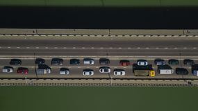 Drone\'s Eye View - Aerial top down view of urban traffic jam on bridge. Aerial road view of traffic jam on a car bridge stock photography