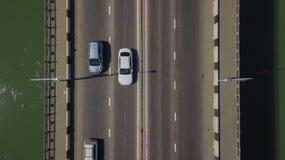 Drone\'s Eye View - Aerial view of urban traffic jam on bridge. Aerial road view of traffic jam on a car bridge royalty free stock photos