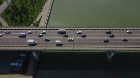 Drone\'s Eye View - Aerial view of urban traffic jam on city bridge. Aerial road view of traffic jam on a car bridge royalty free stock image