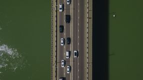 Drone\'s Eye View - Top down view from above of urban traffic jam with cars and truck on bridge. Aerial road view of traffic jam on a car bridge stock photo