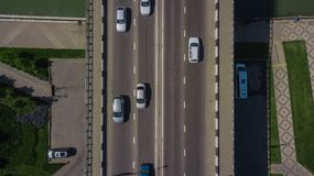 Drone\'s Eye View - Top down view from above of urban traffic jam with cars and truck on bridge. Aerial road view of traffic jam on a car bridge stock images