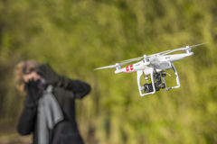 Drone scares woman flying around her royalty free stock photo
