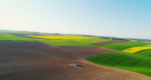 Drone shoot of tractor fertilizing soil. stock video