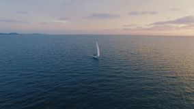 Yacht shoot by drones in the sea at sunset stock video