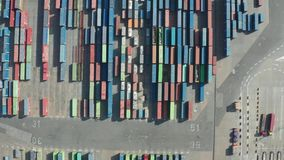 Drone shot of Barcelona port with caro containers. Top view of colorful cargo containers in modern industrial port of Barcelona. Aerial shot of import export stock footage