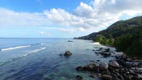 Aerial view of Beau Vallon beach and rocks, Mahe Island, Seychelles 7. Drone shot of Beau Vallon Beach, Mahe Island, Seychelles stock video footage
