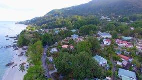 Aerial view of houses, Beau Vallon Beach, Mahe Island, Seychelles 1. Drone shot of Beau Vallon Beach, Mahe Island, Seychelles stock video footage