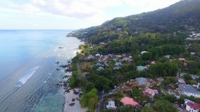 Aerial view of houses, Beau Vallon Beach, Mahe Island, Seychelles 2. Drone shot of Beau Vallon Beach, Mahe Island, Seychelles stock video footage