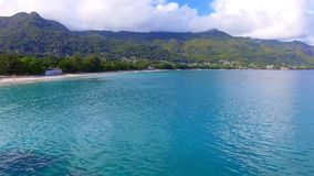 Aerial View Of Ocean, Beach and Mountains On The Tropical Island, Seychelles 4. Drone Shot Of Beau Vallon Beach, Ocean and Mountains On The Beach Of Tropical stock video