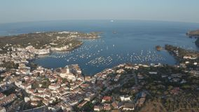 Drone shot of beautiful bay and old town Cadaques. Aerial shot of coastal town Cadaques with bay against scenic seascape. Drone view of Cap de Creus peninsula`s stock video