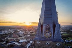 Golden hour church tower. Drone shot close up of a church tower clock at golden hour Royalty Free Stock Photo