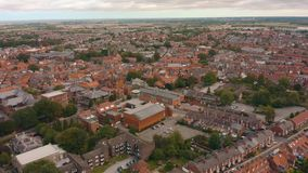 Aerial view of Beverley Minster and the surrounding town in East Yorkshire, UK - 2019. Drone shot of the famous religious building and the surrounding town in stock video footage