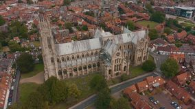 Aerial view of Beverley Minster and the surrounding town in East Yorkshire, UK - 2019. Drone shot of the famous religious building and the surrounding town in stock footage