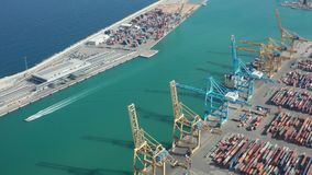 Aerial view of modern industrial port in Barcelona. Drone shot of import and export cargo terminal with shipping docks, gantry cranes and many colorful stock video footage